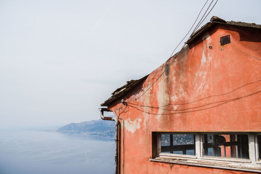 By The Sea Empty House San Rocco Abandoned Abandoned Buildings Building Exterior Built Structure Clear Sky Day Horizon Over Water Liguria Mountains Nature No People Outdoors Punta Chiappa Red Red Wall Sea Sky Water Window Wires The Week On EyeEm