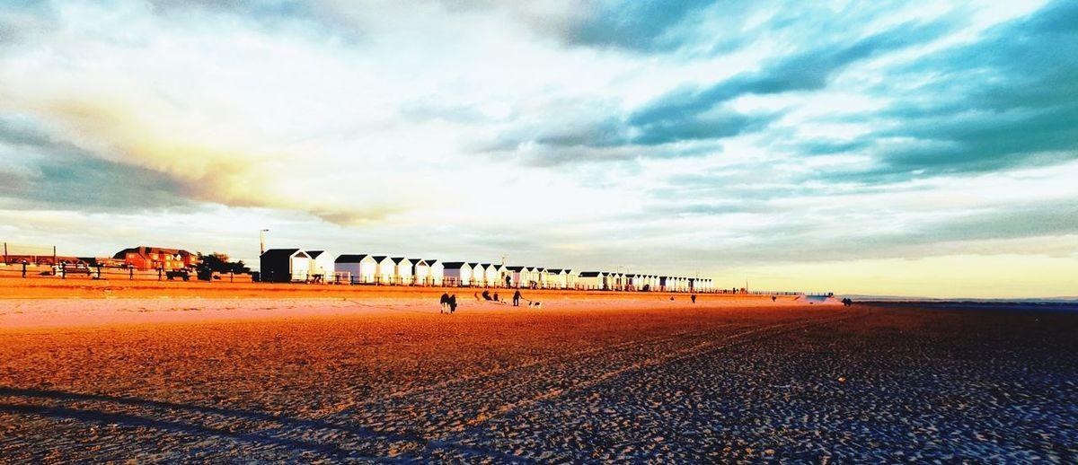 beach huts Beach Life Beach Huts Eye4photography  EyeEm Best Shots Eyeemphotography Beachphotography Beach Sand Sport Sunset Sky Cloud - Sky Dramatic Sky Atmospheric Mood Moody Sky Cloudscape