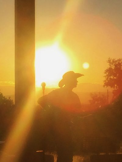 Singing at Sunset Cowboy Santa Fe, New Mexico Country Music Day House Concert Lifestyles Muscian  Nature Orange Color Outdoors People Real People Silhouette Sky Standing Sun Sunlight Sunset Tree EyeEmNewHere