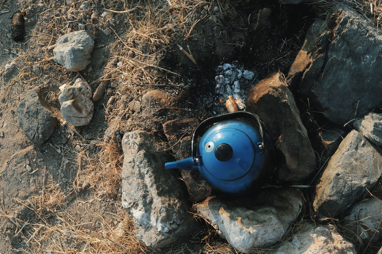 High Angle View Of Teapot On Field