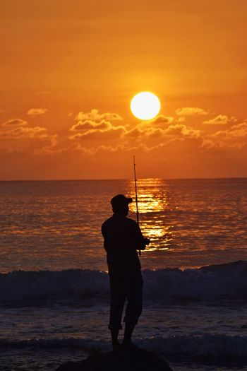 Fishing with Sunset Beauty In Nature Beautiful Beauty Portrait Portrait Photography Sun Sunlight Nikon Nikonphotography INDONESIA Indonesia Photography  Aceh Water Sea Full Length Sunset Beach Standing Silhouette Sun Men Rear View Romantic Sky Dramatic Sky Fishing Rod Fishing Fisherman Catch Of Fish Fishing Hook Capture Tomorrow EyeEmNewHere My Best Photo