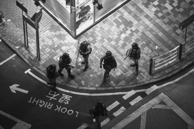 High angle view of people walking in city