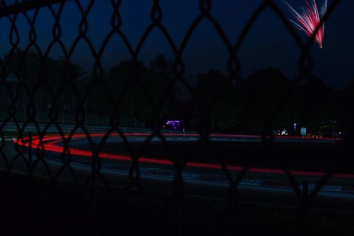 setting in for the nightshift Protection Safety Security Chainlink Fence Outdoors Night Road Water Real People Tree Sky Nature City Racing Lights Brakelights Long Exposure No People Illuminated 24hoursofnurburgring Nürburgring Racetrack Nurburgring