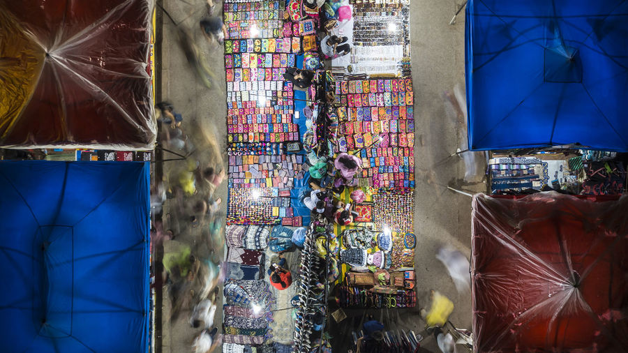 High angle view of various objects for sale at market stall at night