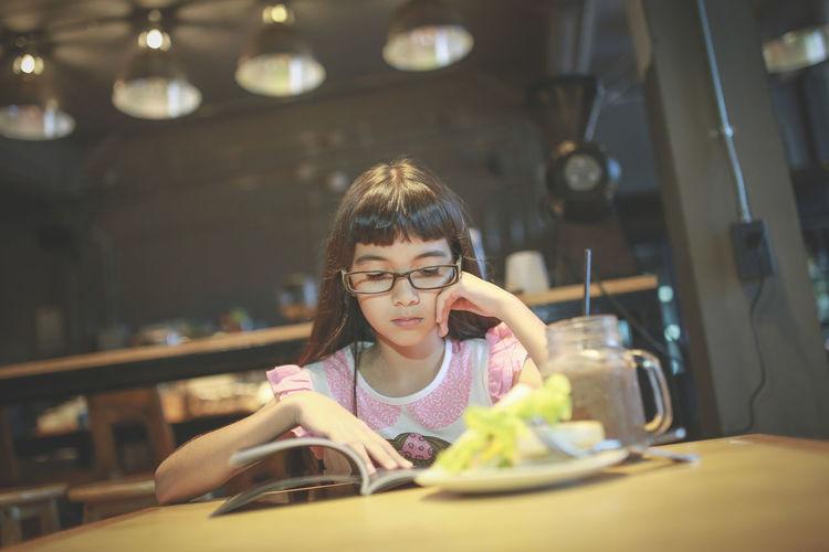 Portrait Of Girl Reading Book