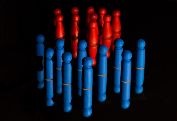 blue and red - men and women separated Divided Abundance Arrangement Black Background Blue Close-up Creativity Focus On Foreground In A Row Indoors  Large Group Of Objects Men And Women Multi Colored No People Order Pattern Red Segregation  Selective Focus Separation Side By Side Still Life Studio Shot