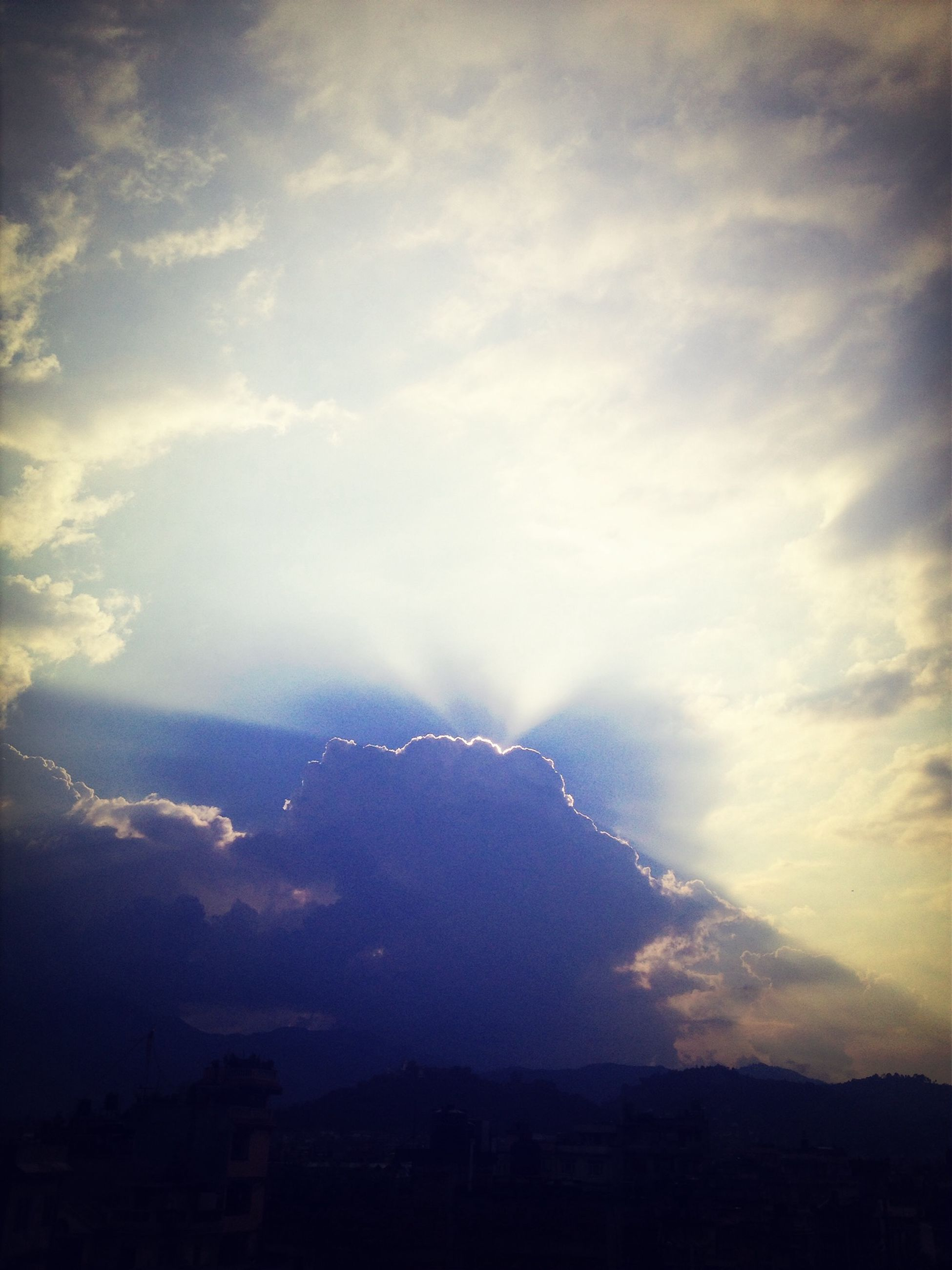 sky, cloud - sky, scenics, beauty in nature, tranquil scene, tranquility, mountain, cloudy, nature, silhouette, weather, cloud, landscape, idyllic, dusk, cloudscape, mountain range, outdoors, overcast, dramatic sky