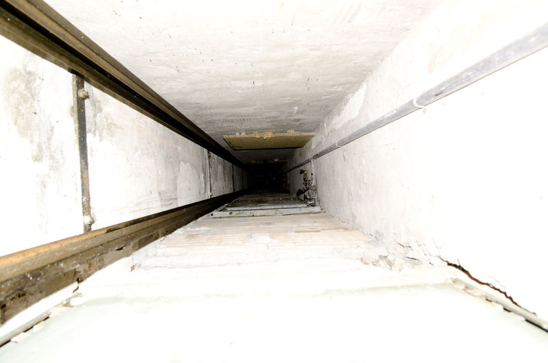 Elevator shaft Architecture Binary Built Structure Built Structure. Day Diminishing Perspective Elevator Elevator Shaft Empty High Key Hole Indoors  No People No Return  Shaft Surrounding Wall The Way Forward Tunnel Wall Wall - Building Feature