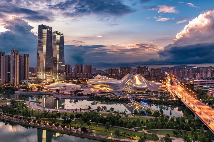 Aerial View Of Illuminated Bridge And Buildings Against Sky