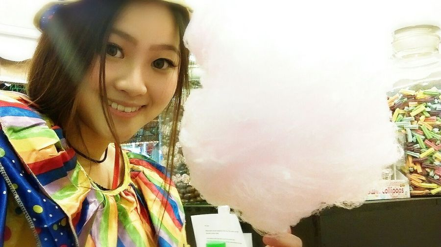 Working at a carnival...dressed as a clown making candy floss and popcorn......That's Me Candy Floss Cotton Candy Clown
