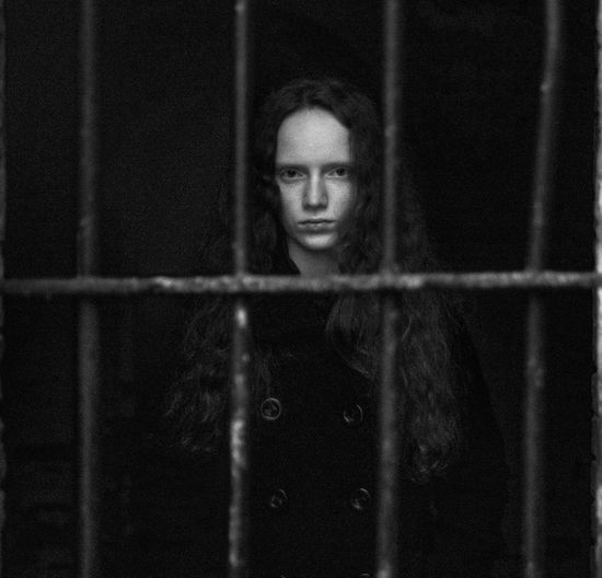 Portrait of girl in cage