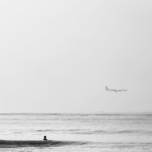 Enjoy the flight.. Monochrome Photography Monochrome Silhouette Light And Shadow People EyeEm Life Is A Beach INDONESIA Snapshot Traveling Taking Photos EyeEm Best Shots Enjoying Life Eye4photography  Beach Monoart Blackandwhite Photography Blackandwhite