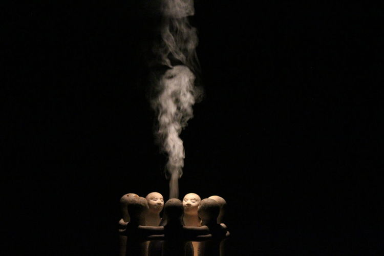 Wooden Objects Surrounded By Smoke