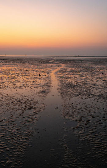 Sunset Sky Water Scenics - Nature Sea Beauty In Nature Tranquility Tranquil Scene Land Beach Horizon Orange Color Non-urban Scene No People Horizon Over Water Idyllic Nature Reflection Sand Outdoors Low Tide