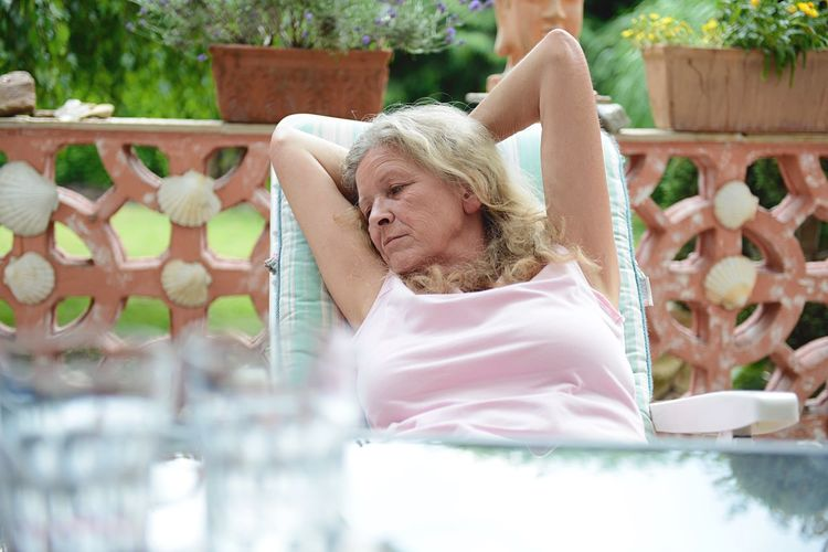 Mature Woman Relaxing On Porch