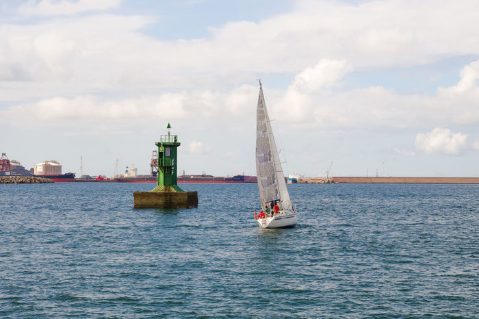 A yacht sailing next to large green buoy in the port of Gijon. Travel Beauty In Nature Boat Buoy Buoy On The Water Cloud - Sky Day Green Buoy Mast Mode Of Transport Nature Nautical Vessel No People Outdoors Port Sailboat Sailing Sailing Ship Sea Sky Tourism Transportation Travel Destinations Water Waterfront