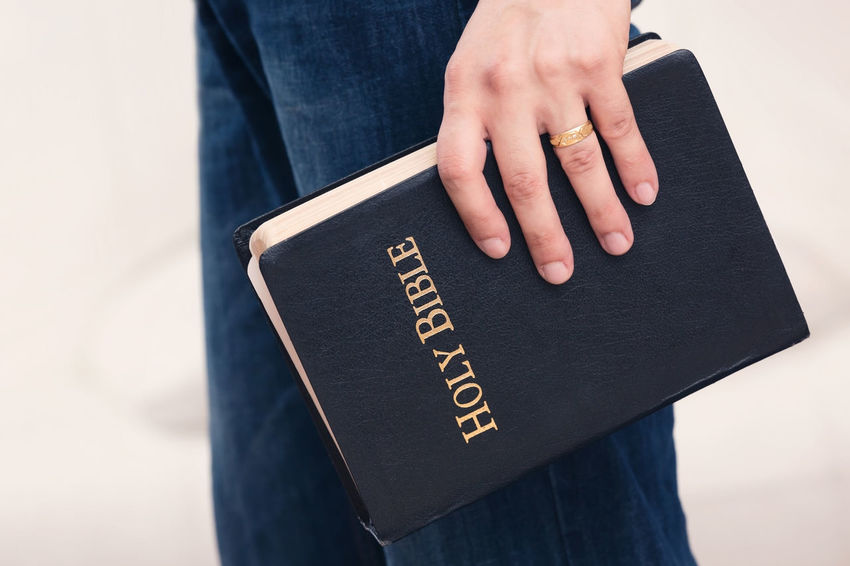 Man Holding Bible to His Side Adult Christian Christianity Disciple Man Preacher Spirituality Student Bible Education Evangelism Gospel Pastor person Religion School Scripture Study Theology
