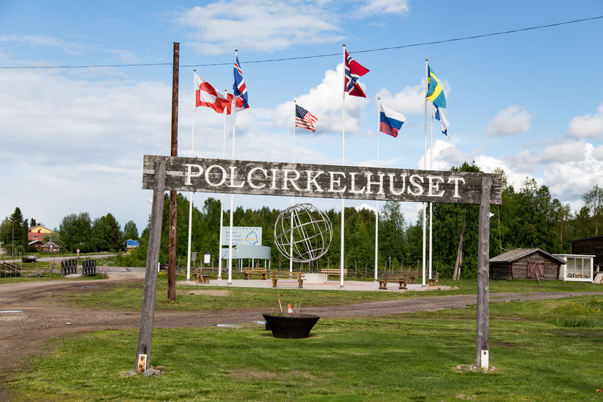Polar circle at Juoksengi Canadian Flag Finnish Flag Flag Of Greenland Flags Greenlandic Flag Icelandic Flag Juoksengi Midsummer Norwegian Flag Polar Circle Polcirkelhuset Russian Flag Star Spangled Banner Sweden Swedish Flag United States Flag
