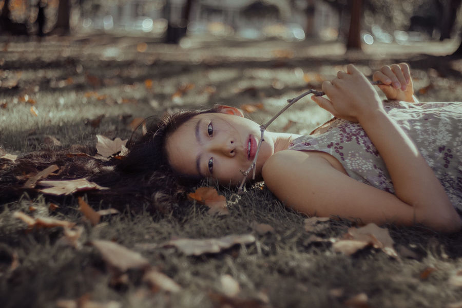 Childhood Close-up Day Girl Lying Down Melbourne One Person Outdoors People Portrait Portrait Of A Woman Portrait Photography Portraits Real People Relaxation The Portraitist - 2017 EyeEm Awards Women Women Around The World Young Adult Young Women