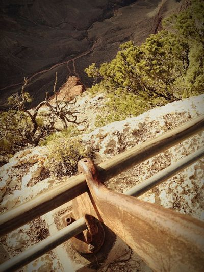 railing overboard Brown Grand Canyon Canyon Railing Beach Sand Shadow Sunlight High Angle View Close-up