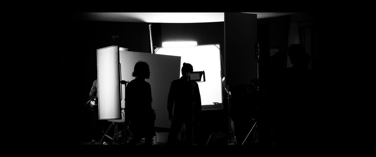 Shooting studio behind the scenes in silhouette images which film crew team working for filming movie or video with professional lighting and equipment such as camera, tripod, soft box, monitor Men Real People Indoors  Standing Silhouette People Illuminated Lifestyles Lighting Equipment Business Adult Light - Natural Phenomenon Occupation Women Rear View Leisure Activity Full Length Dark Behind The Scenes Studio; Photo; Shoot; Photography; Photographer; Equipment; Film; Model; Fashion; Professional; Behind; Shooting; Background; Camera; Photoshoot; People; Tv; Production; Lighting; Product; Scenes; Set; Woman; Light; Video; Black; Movie; Photograph; Scene;