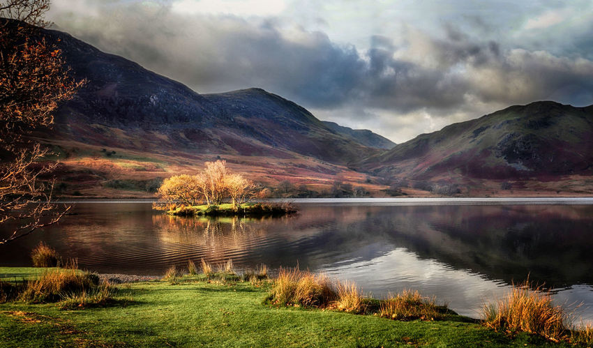Crummock Water in Autumn in the English Lake District Crummock Water Lake District National Park Beauty In Nature Cloud - Sky Day District Grass Idyllic Lake Lake View Landscape Mountain Mountain Range Nature No People Outdoors Reflection Reflections Scenics Sky Tranquil Scene Tranquility Tree Water