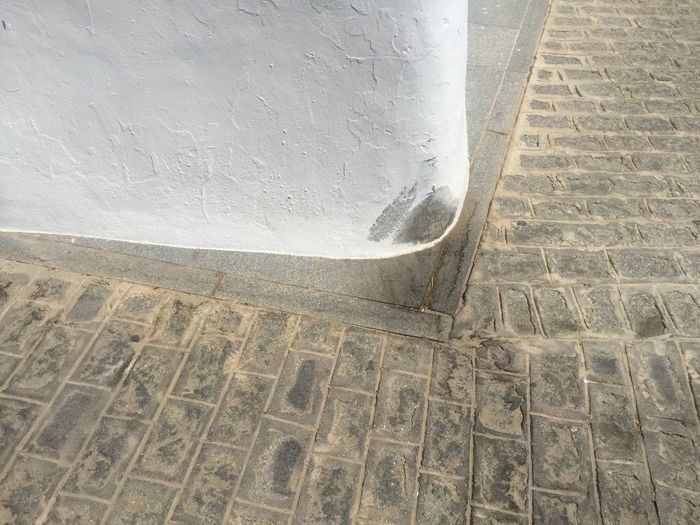 Architecture No People Day Pattern Outdoors High Angle View Built Structure Architecture No People Day Pattern Outdoors High Angle View Built Structure Wall - Building Feature Footpath Close-up Wall Street Textured  Sunlight Building Exterior Paving Stone