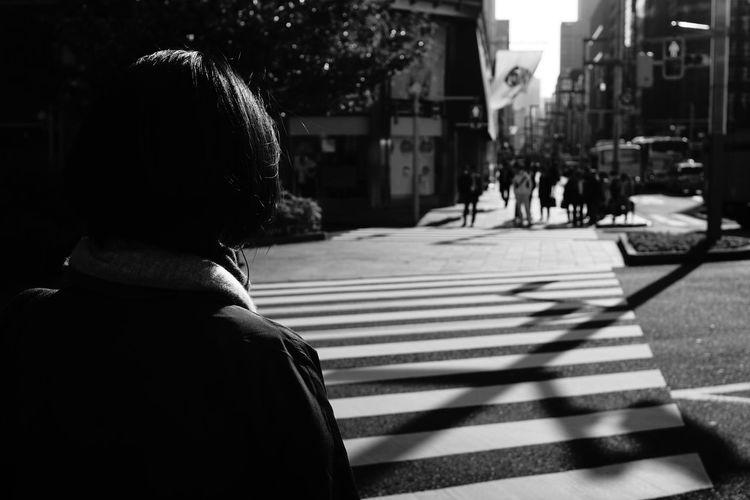 Rear view of woman walking on street