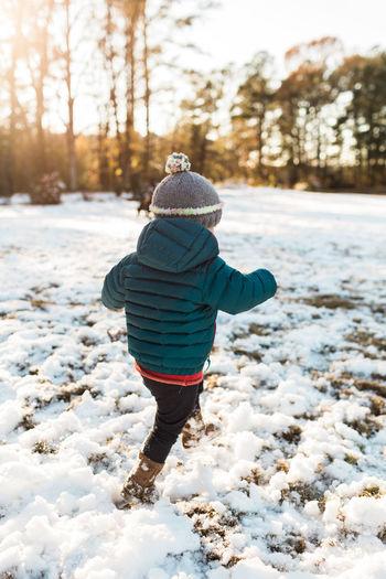 Rear view of boy in snow
