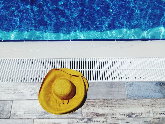 Relaxing Moments Relaxing Time Yellow Hut Vacations Holiday Beach Swimming Pool Water Summer Blue Yellow Sand Sun Hat Poolside Pool Party Pool One Piece Swimsuit Sun Lounger Sunbathing The Minimalist - 2019 EyeEm Awards The Creative - 2019 EyeEm Awards