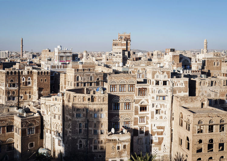 old town traditional architecture buildings of Sana'a city in Yemen Ancient Arabian City Old Town Sana'a Yemen Arabic Architecture Building Building Exterior Built Structure City Historic Sanaa Style Traditional Architecture Urban Yemeni