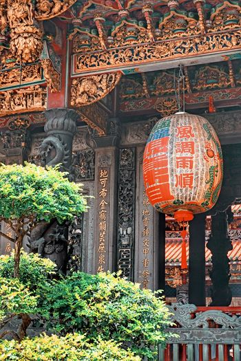 Architecture No People Built Structure Day Religion Building Plant Pattern Nature Art And Craft Outdoors Non-western Script Sunlight Building Exterior Ornate Place Of Worship Belief Spirituality Lantern Text