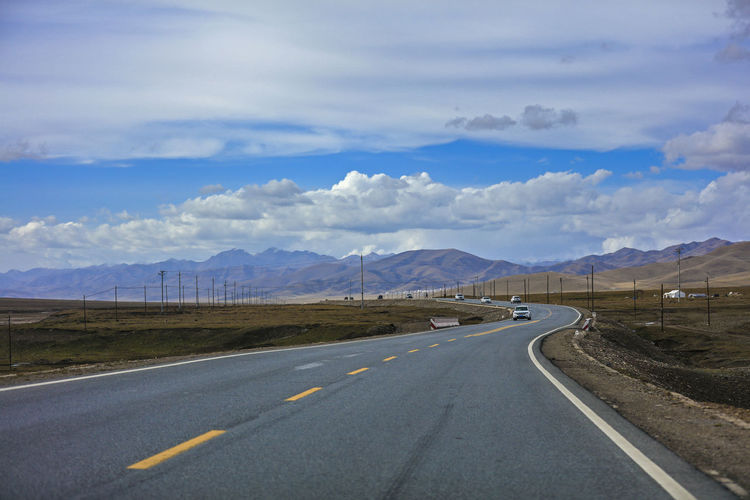 Cloud - Sky Day Dividing Line Landscape Mountain Mountain Range Nature No People Outdoors Road Road Marking Scenics Sky The Way Forward Transportation Winding Road Shades Of Winter An Eye For Travel