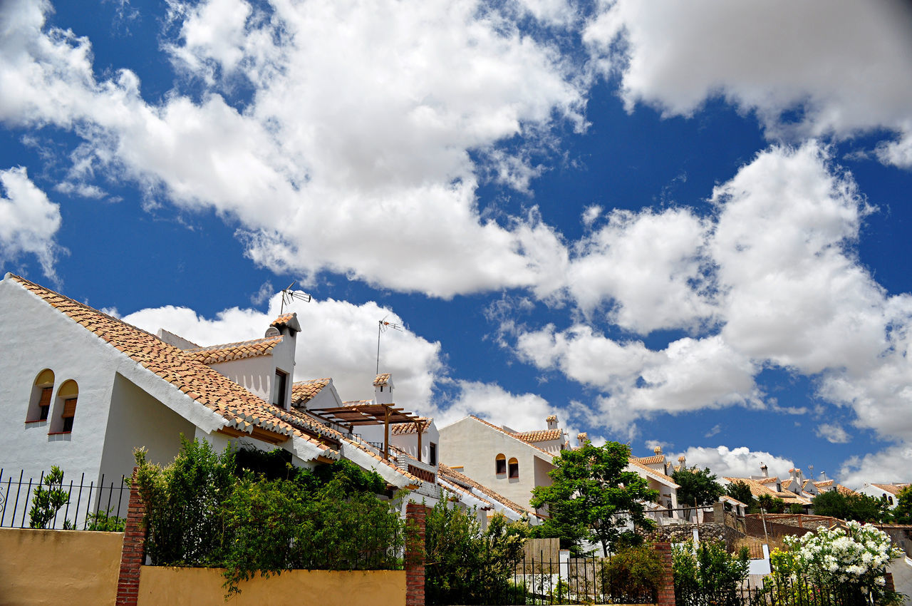 architecture, built structure, building exterior, cloud - sky, sky, house, tree, residential building, town, low angle view, no people, day, outdoors, city, nature