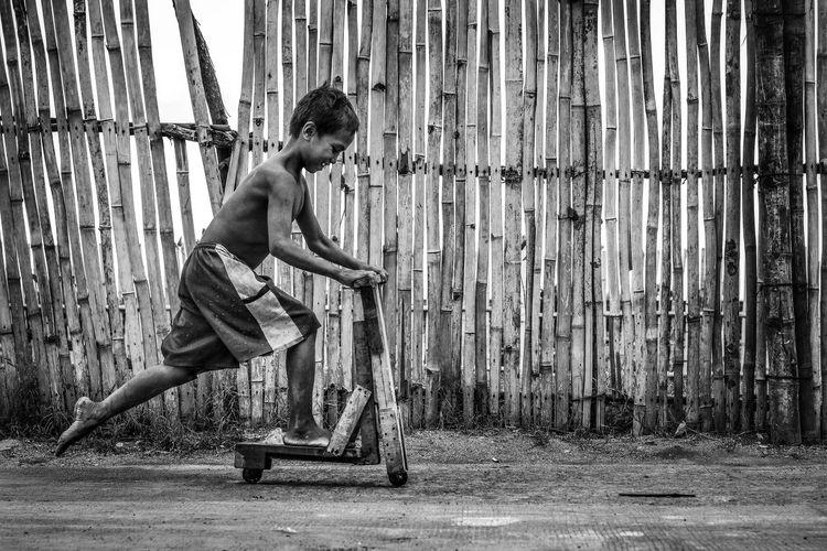 Troli Playing Kid Streetphotography Blackandwhite Sportsman Men Full Length Shirtless Childhood Strength