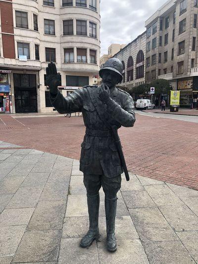 Full length of man standing on street against building