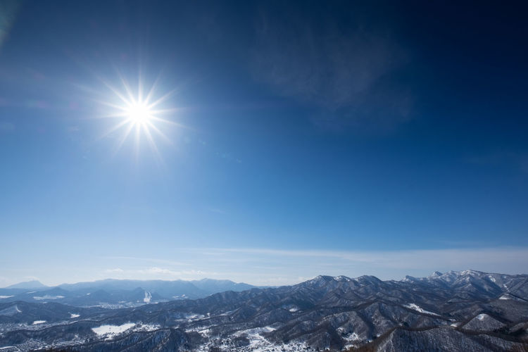Mountain Sky Snow Scenics - Nature Mountain Range Winter Environment Cold Temperature Nature Sun Beauty In Nature Sunlight Tranquility Landscape Day Tranquil Scene No People Sunbeam Snowcapped Mountain Lens Flare Outdoors Mountain Peak Bright Climate Japan