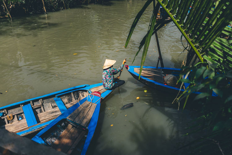 Boat Tour on the Mekong Water Nautical Vessel Transportation Mode Of Transportation One Person Day Nature Real People High Angle View River Outdoors Moored Oar Men Holding Travel Lifestyles Floating On Water Rowboat