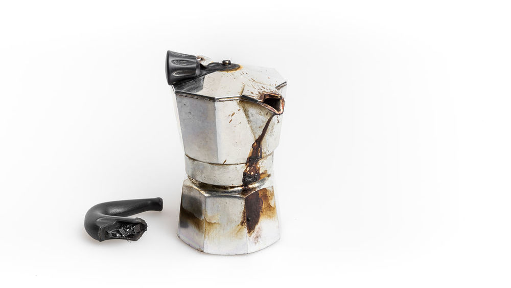 Vintage Moka pot forgotten on the fire. Burned with in molten plastic components. Aluminum Backgrounds Black Breakfast Broken Burned Classic Closeup Coffee Coffeemaker Disaster Down Drink Espresso Fire Handle Hot Isolated Italian Italy Machine Maker Melted Metal Mocha