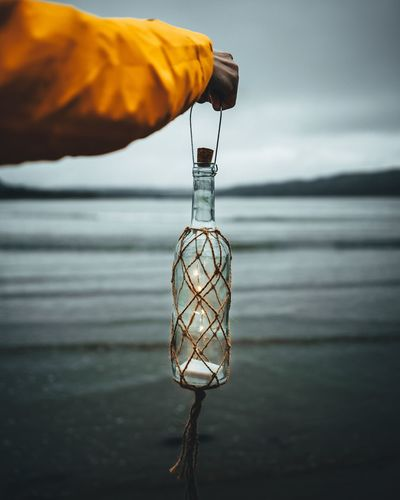 Sea And Sky Seascape Lantern Bottle Unitedkingdom EyeEm Selects Mistery Atmosphere Misterious Nature Hanging Water Close-up Sky Horizon Over Water Calm Bottle Cap Tide Coast Fishing Industry Fisherman