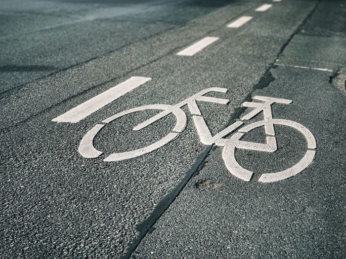 High angle view of bicycle sign on road