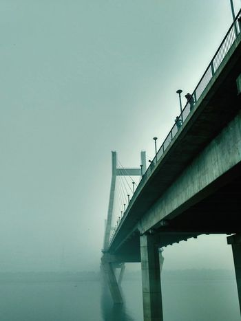 Bridge - Man Made Structure Water Connection Fog River Silhouette Outdoors Sky Tranquility Built Structure Scenics Beauty In Nature No People Lovely Weather Peace Eyem Shots Beautiful Engineering Sunset Yamuna River Allahbad India Incredibleindia Winterscapes Winters