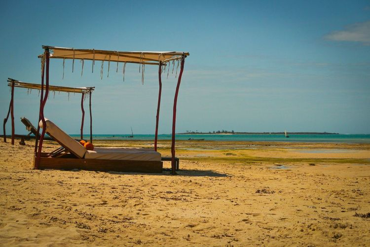 Mozambican sun 🇲🇿 Sand Beach Sea Beauty In Nature Nature Scenics Water Tranquility Tranquil Scene Horizon Over Water Sky Outdoors Day No People Childhood Clear Sky beds on tropical beach