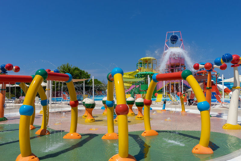 Summer Vacation Summertime Arts Culture And Entertainment Blue Childhood Clear Sky Day Enjoyment Fun Jungle Gym Leisure Activity Multi Colored Nature Outdoor Play Equipment Outdoors Park Plastic Playground Playing Sky Slide - Play Equipment Summer Swimming Pool Water Water Park