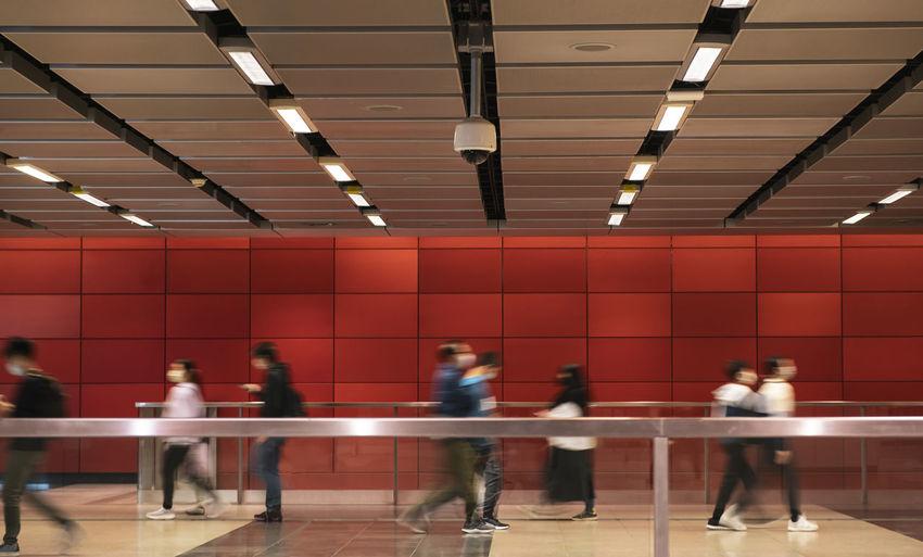People walking on illuminated subway station