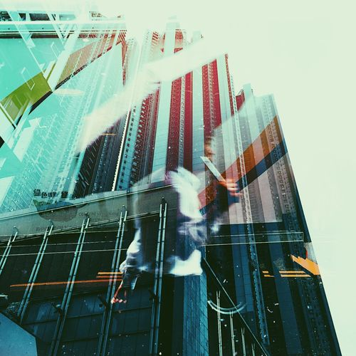 Double Exposure Hong Kong Architecture Blurred Motion Building Exterior Built Structure City Day Low Angle View Men Modern Motion Outdoors People Skyscraper Street Streetphotography