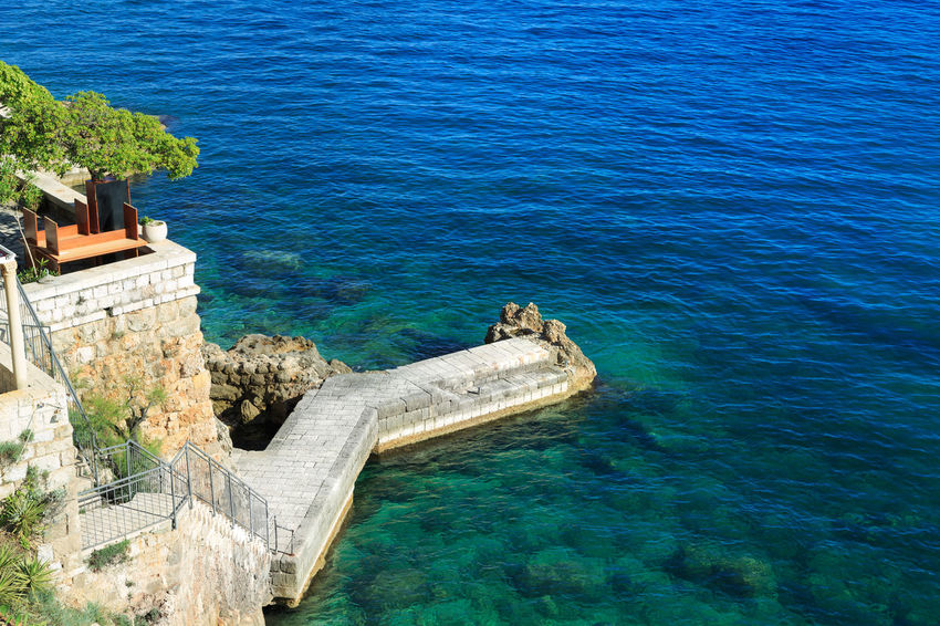 Bohemian quay at the rocky limestone seaside in Dubrovnik, Croatia Adriatic Adriatic Sea Aquamarine Architecture Beautiful Bohemian Crotia Dubrovnik Gorgeous Luxury Medieval Town Nature Old Town Quay Sea Tourism Travel Unesco UNESCO World Heritage Site