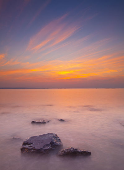 sunrise at kenjeran beach Sky Tranquility Horizon Beauty In Nature Tranquil Scene Cloud - Sky Scenics - Nature Rock Horizon Over Water Nature Sea Land Outdoors Idyllic Rock - Object Sunset Water Orange Color Solid No People Romantic Sky