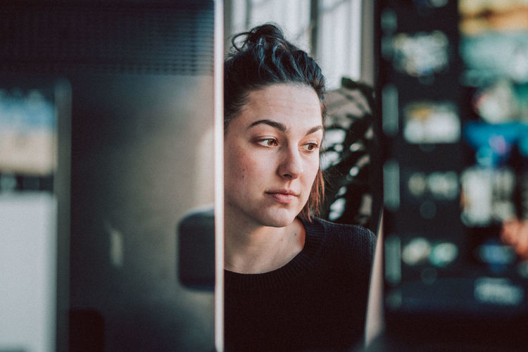 One Person Portrait Headshot Young Adult Front View Indoors  Real People Contemplation Young Women Adult Looking Women Working Office