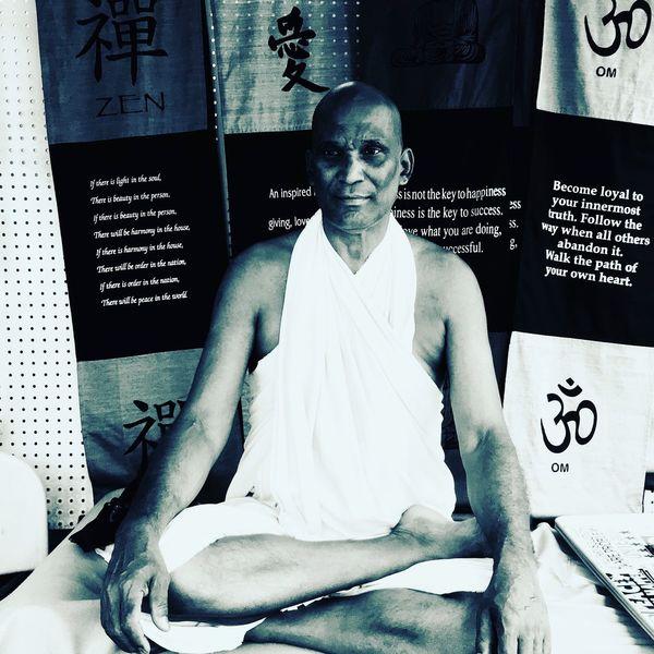 Market Monk Monk  Kona Hawaii Indoors  Front View Portrait Leisure Activity Looking At Camera Sitting Creativity